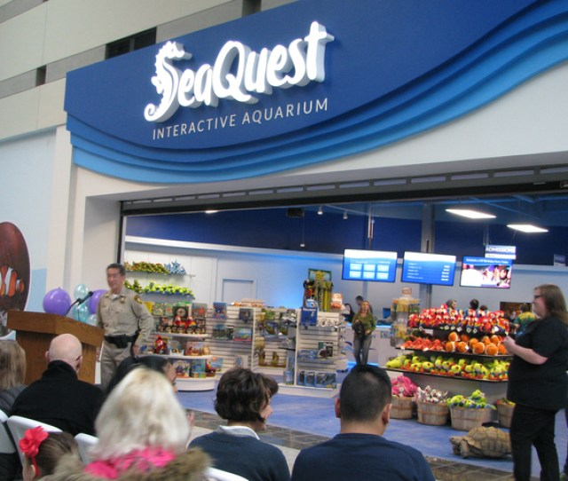 Lt Patrick Charon Speaks At The Ribbon Cutting Event At Seaquest Interactive Aquarium In The