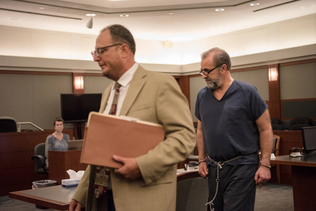 Jailed estate attorney Robert Graham, with his lawyer Bryan Cox, pleads guilty to stealing millions of dollars from his clients during a court hearing on Thursday, Sep. 7, 2017, at Regional Justic ...