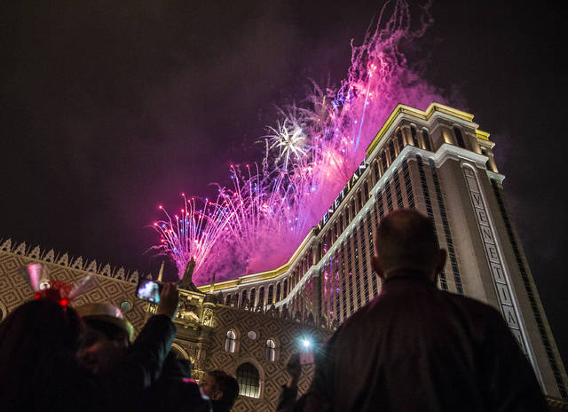 23 New Years Eve parties on the Las Vegas Strip     Las Vegas Review     New Year s Eve party goers watch the fireworks outside the Venetian  hotel casino on the