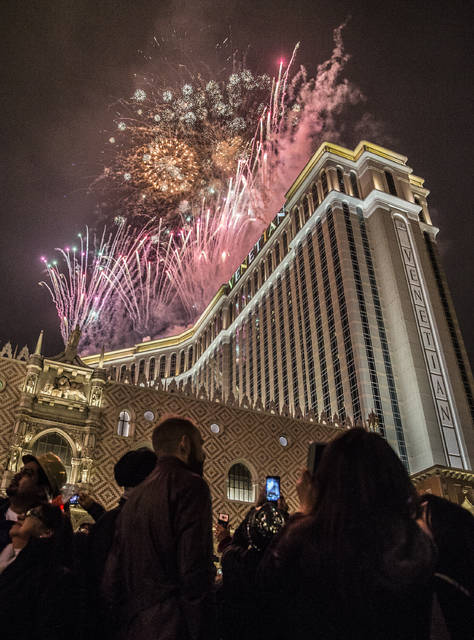 Las Vegas to see 330 000 revelers for New Year s Eve     Las Vegas     New Year s Eve party goers watch the fireworks outside the Venetian  hotel casino on the