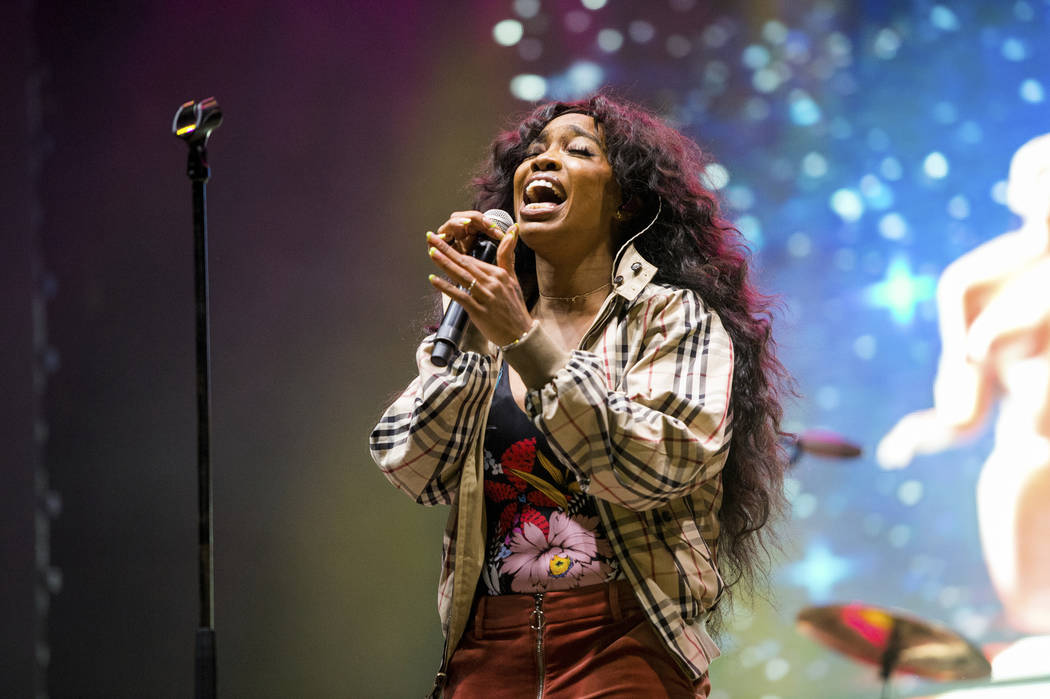 FILE - In this March 9, 2018 file photo, SZA performs at the 2018 BUKU Music + Art Project at Mardi Gras World in New Orleans. A list of nominees in the top categories at the 2019 Grammys, includi ...