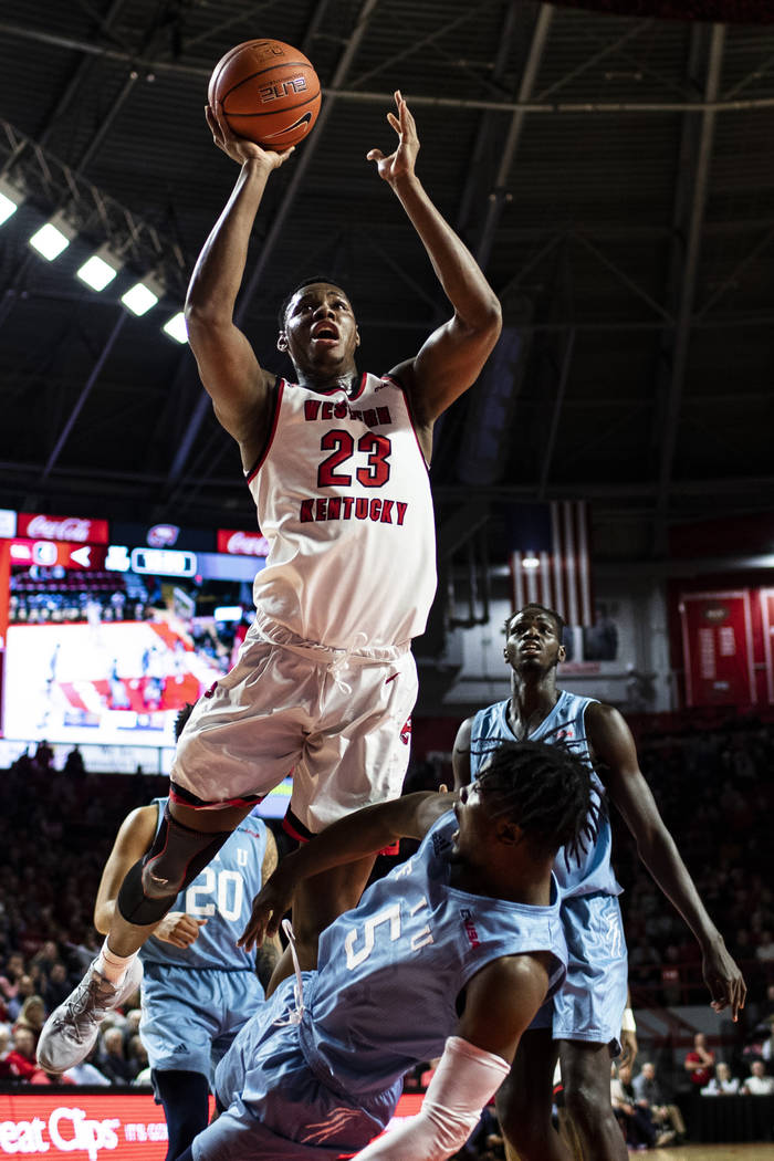 Western Kentucky center Charles Bassey (23) is called for an offensive foul  against Florida Int …   Las Vegas Review-Journal