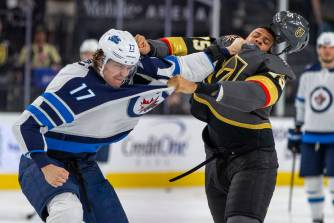 Winnipeg Jets left wing Adam Lowry (17) and Vegas Golden Knights right wing  Ryan Reaves (75) sc … | Las Vegas Review-Journal
