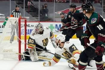 Coyotes forward Christian Dvorak scores on Golden Knights goaltender Robin Lehner