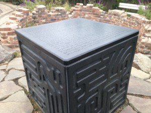 The command cube embedded in the ground with engravings on it