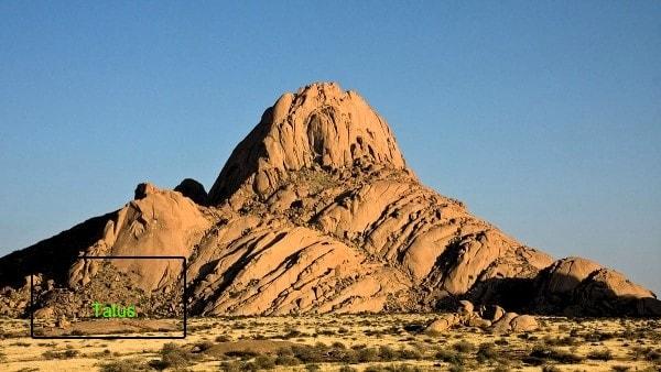 An inselberg in the Namib Desert. Image credit MediaWiki.