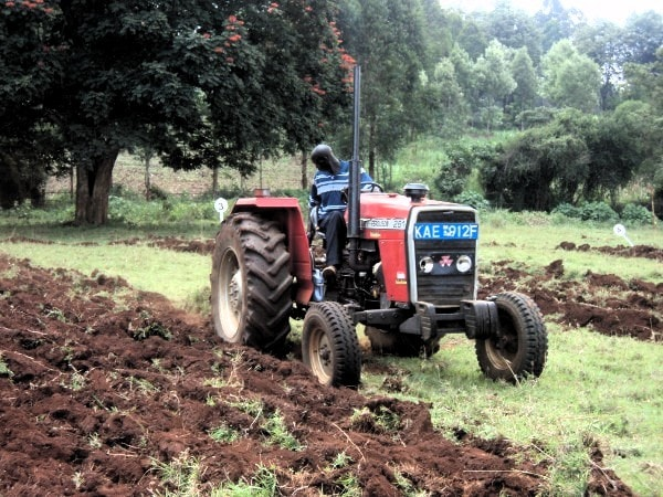 A tractor is a man-made aid to production and part of capital. Image credit unobi.ac.ke