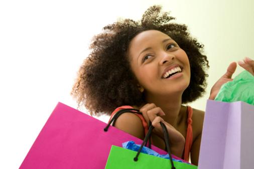 Woman with shopping bags financialjunteenth.com