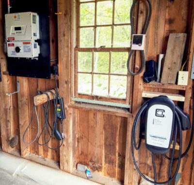An EV charger in the Marples' garage