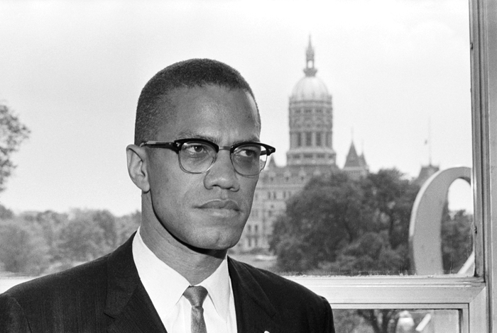 04 Jun 1963, Hartford, Connecticut, USA --- Original caption: 6/4/1963-Hartford, CT: Malcolm X, leading spokesman for the Black Muslim movement, is shown with the dome of the Connecticut Capitol behind him as he arrived in Hartford for a two day visit. --- Image by © Bettmann/CORBIS