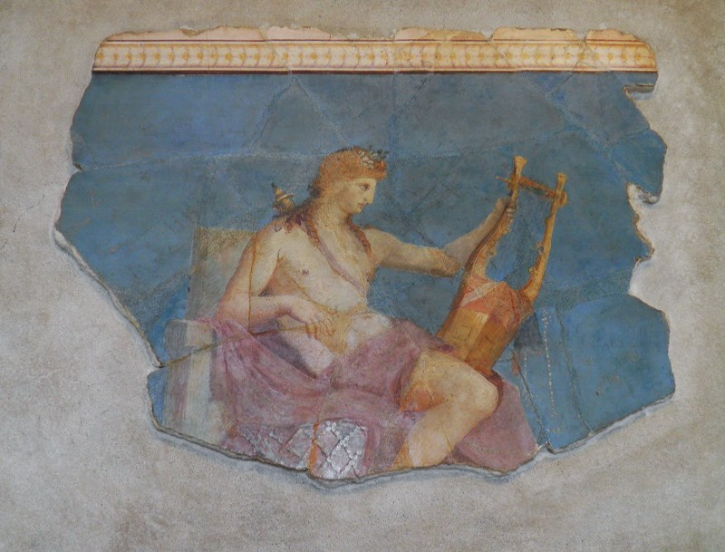 Apolo com a lira, fragmento do afresco perto da casa de Augusto, Museu Palatino, Roma. Wikimedia Commons.