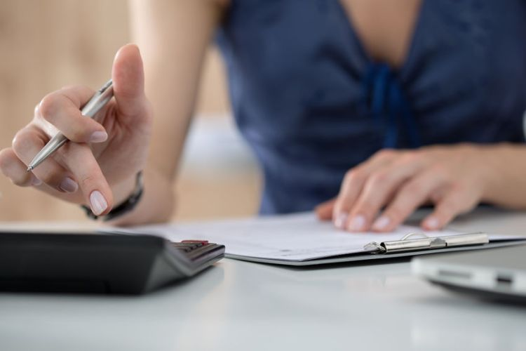 46777415 - close up of female accountant or banker making calculations. savings, finances and economy concept