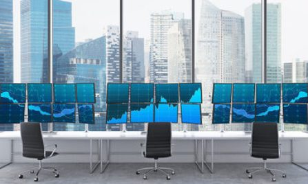 3D rendering of office with 24 switched on monitors, processing data for trading, window at the background, singapore panoramic view