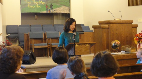 Anna giving her testimony to a group of ladies.