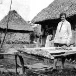 Mildred, displaying dried fish and shrimp for a photo op in the village of Santa Rosa near the Pacific.