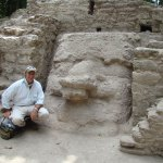 Dr. Hansen with mask on excavated structure