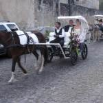 The wedding party arrives to the ceremony in style