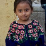 Girl dressed in typical clothing for the Feast of Our Lady of Guadalupe in Antigua Guatemala (photo by Cesar Tian)