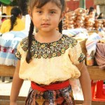 Girl dressed in typical clothing for the Feast of Our Lady of Guadalupe in Antigua Guatemala (photo by Luis Toribio)