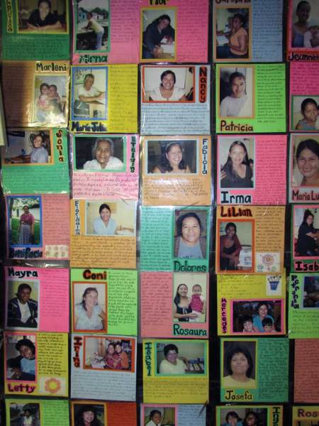 A wall in Camino Seguro's office is covered with pictures of adults who have graduated from elementary school through its programs.