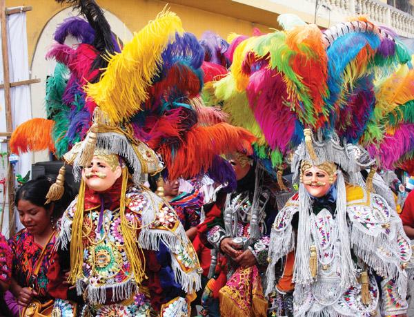 Costumed dancers representing Spanish Conquistadors
