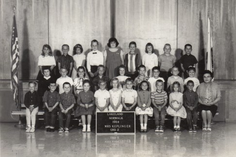 Second Row, Sixth from the Left