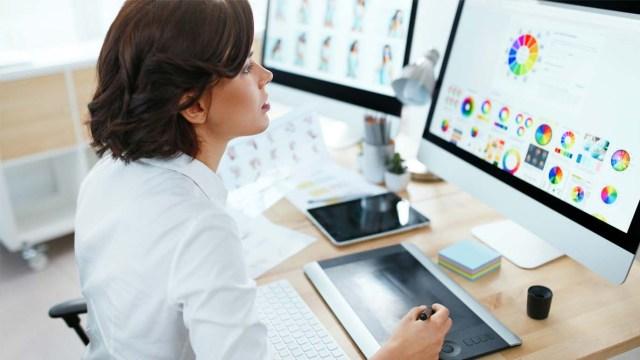 Graphic designer creating brand identity on a computer