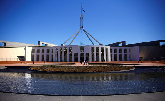 Tourists walk around the forecourt of Australia's Parliament House in Canberra, Australia, October 16, 2017.   Credit: Reuters