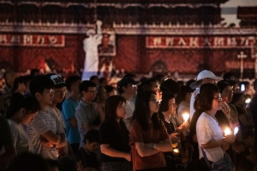 In what turned out to be the final Hong Kong vigil for victims of the 1989 Tiananmen massacre, people attend a candlelight vigil at the city's Victoria Park to mark the 30th anniversary of the 1989 Tiananmen crackdown in Beijing, June 4, 2019. The vigil was banned in 2020 and this year amid coronavirus concerns and a gathering crackdown under a national security imposed by Beijing. Credit: AFP