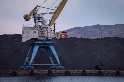 A mountain of North Korean coal -- which would once have been bound for China -- is piled up  in Rajin harbour, stranded by a UN ban on coal exports by Pyongyang, Nov. 20, 2017. Credit: AFP