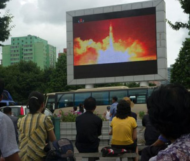 People In A Public Square In Pyongyang Watch The Broadcast Of A North Korean Test Of