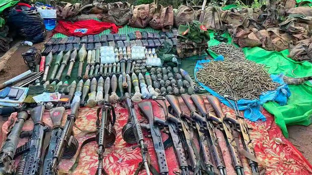 MNDAA soldiers display weapons and ammunition confiscated from government troops in northern Shan state's Mongko township, in an undated photo. MNDAA