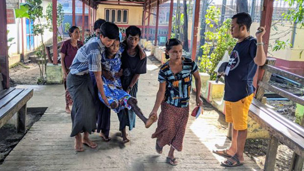 Villagers carry a child injured by a landmine explosion in Ponnygyun township, western Myanmar's Rakhine state, as he is being transported to Sittwe General Hospital for medical treatment, Nov. 3, 2020.