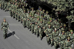 Chinese armed police march along a street in Urumqi, Sept. 5, 2009. (via RFA)