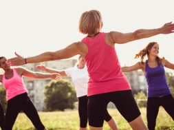 Group of young female friends exercising in a park