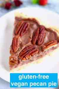 Photo of a slice of pecan pie on a white plate against a marble background