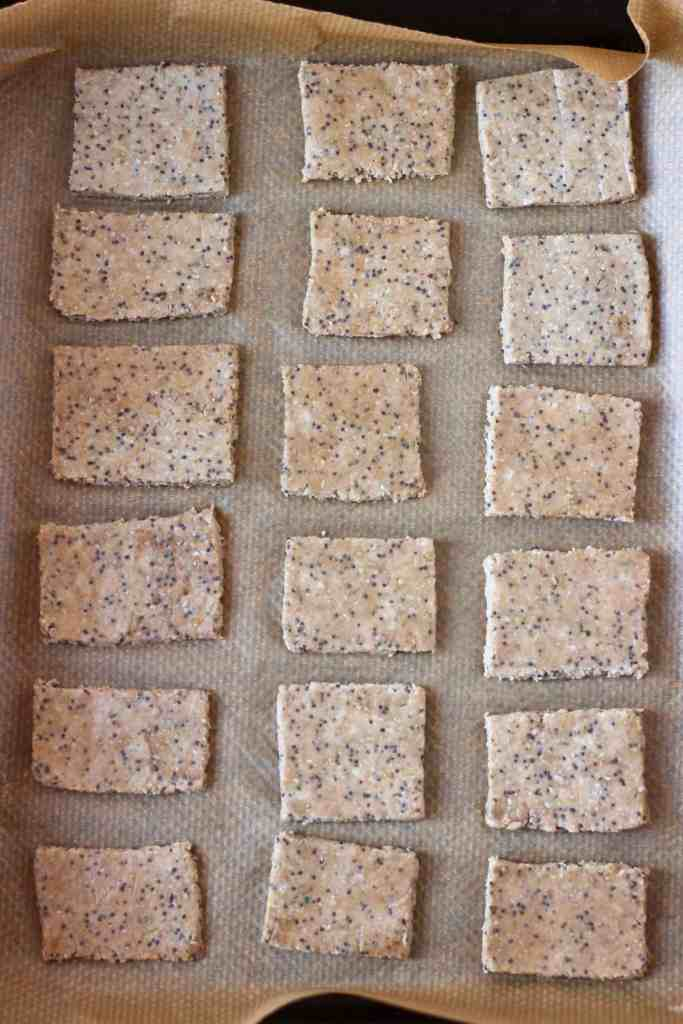 18 square brown crackers on a baking tray