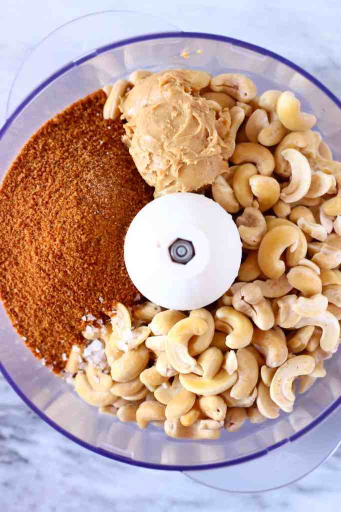 Cashew nuts, peanut butter and coconut sugar in a food processor