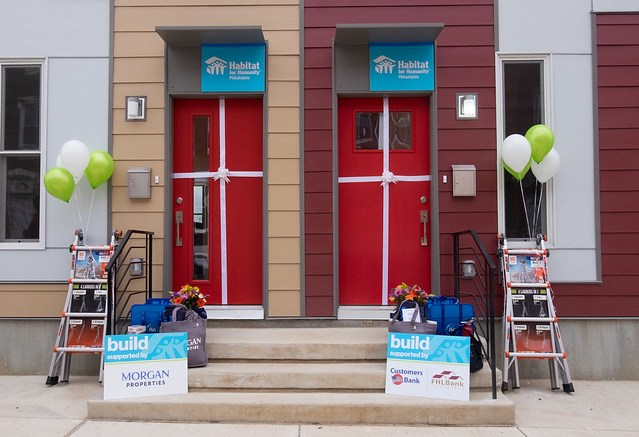 front doors with welcome signs for new homeowners