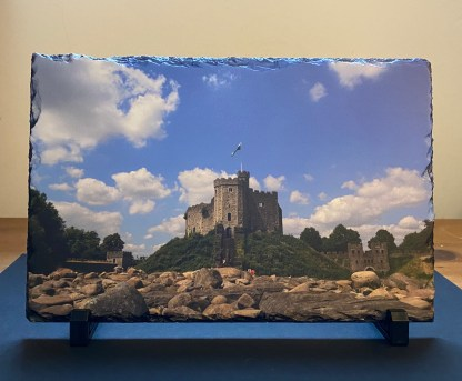 Cardiff Castle keep on the rocks on a photographic slate.Comes with box & mini stands to place slate in.