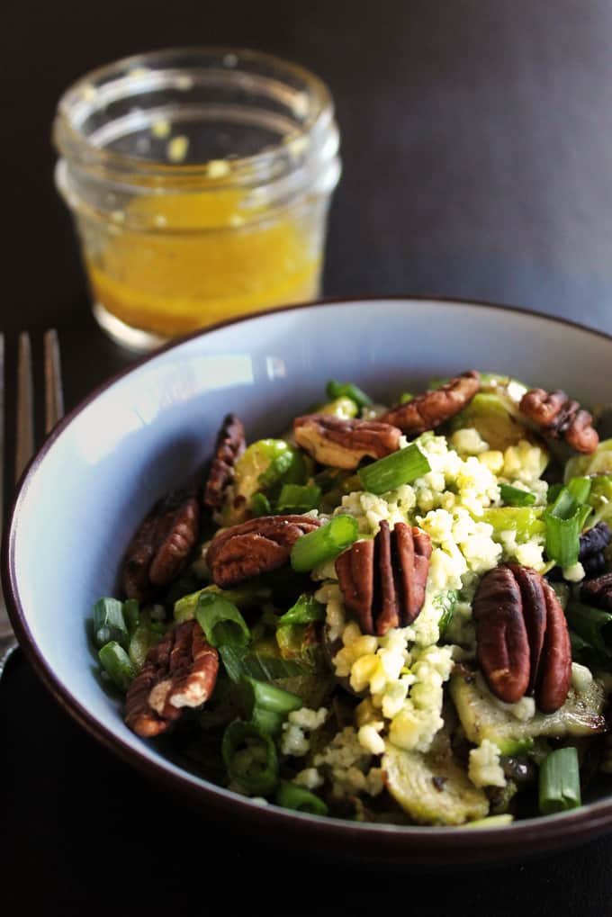 Warm brussels sprout salad with apple cider ginger dressing