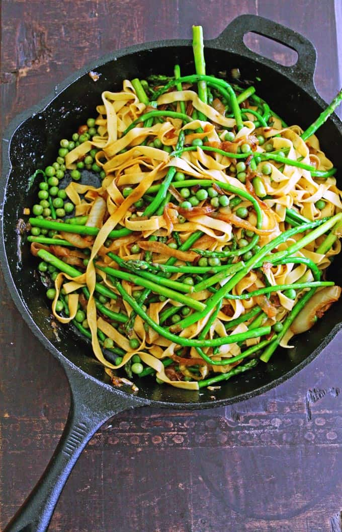 Asparagus and pea pasta with caramelized onion sauce