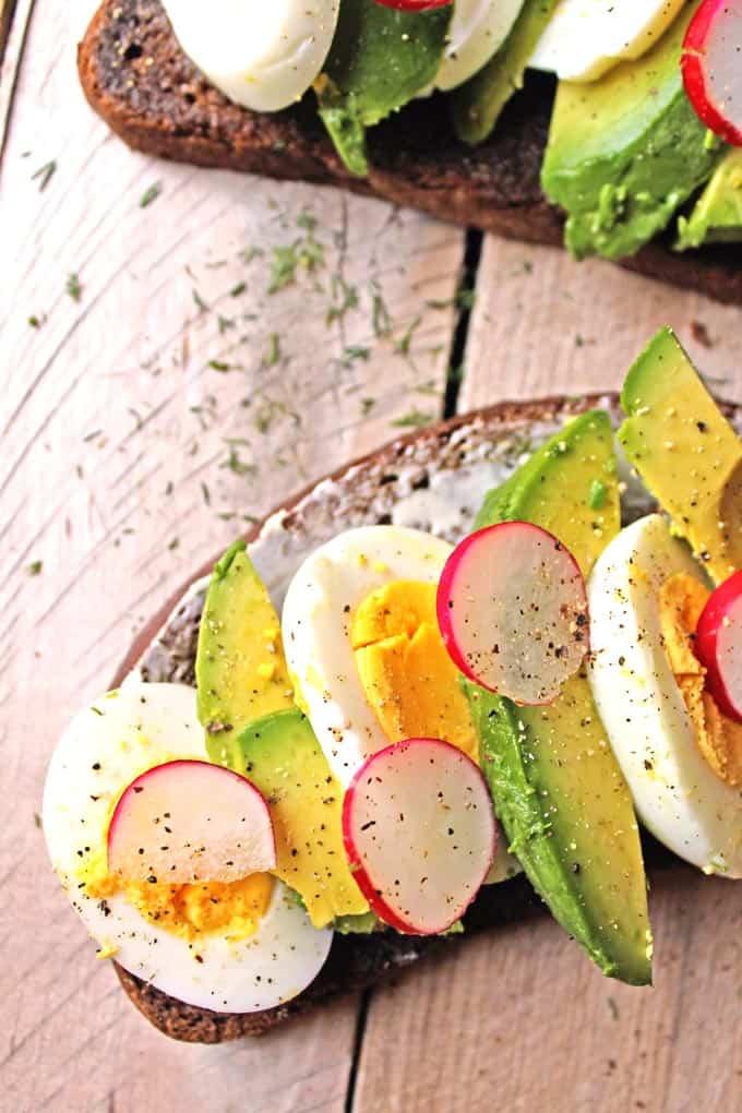 Smorrebrod with egg, avocado, and radish