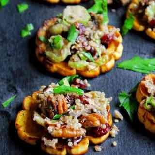 Quinoa stuffed delicata squash rings with mushrooms, cranberries, and pecans