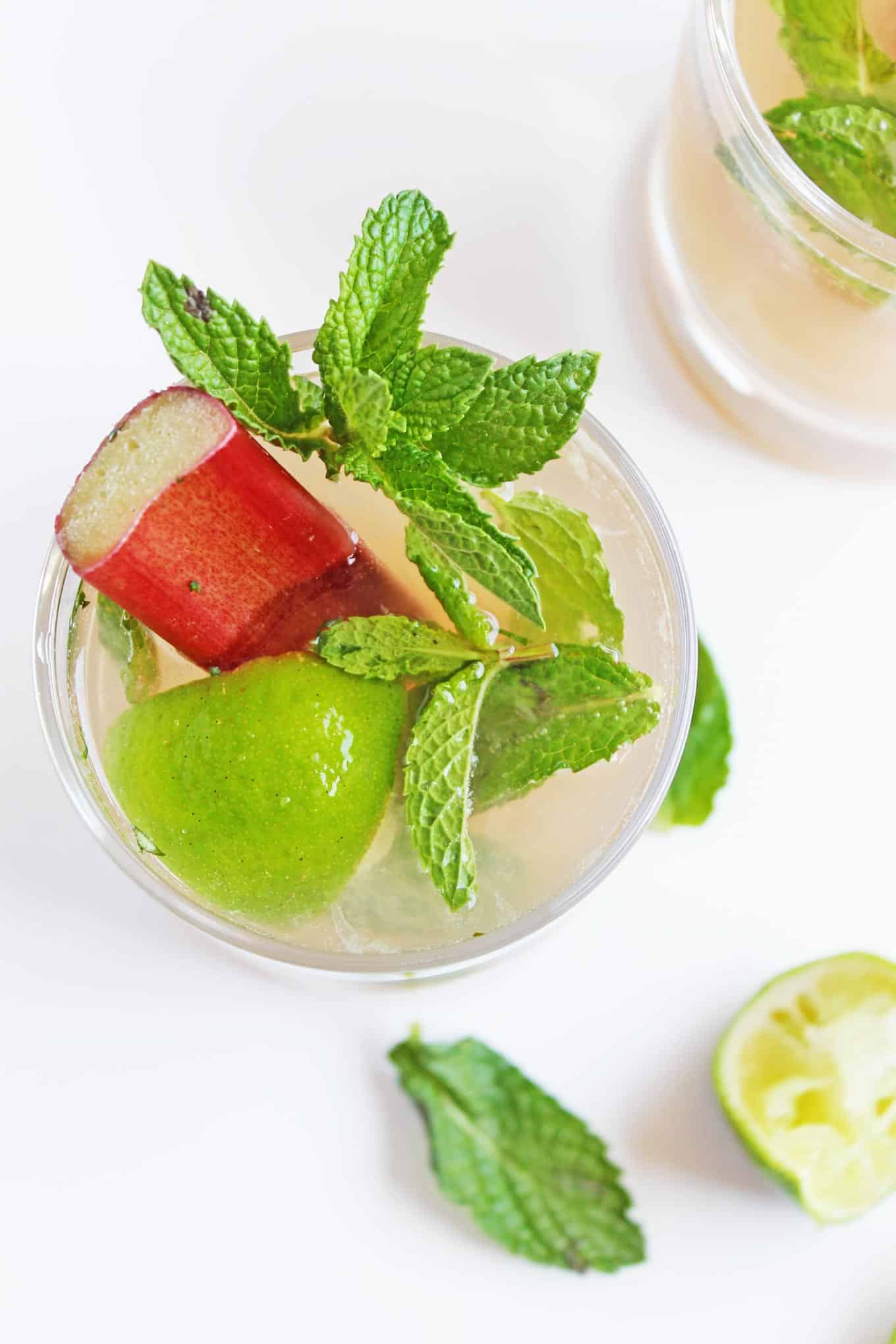 Rhubarb vanilla mojito mocktail recipe! A delicious, alcohol-free twist on the classic mojito cocktail made with YES Beverage's rhubarb vanilla mixer. SO GOOD!