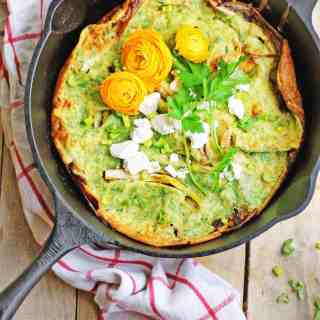 Spring onion dutch baby with herbs and goat cheese