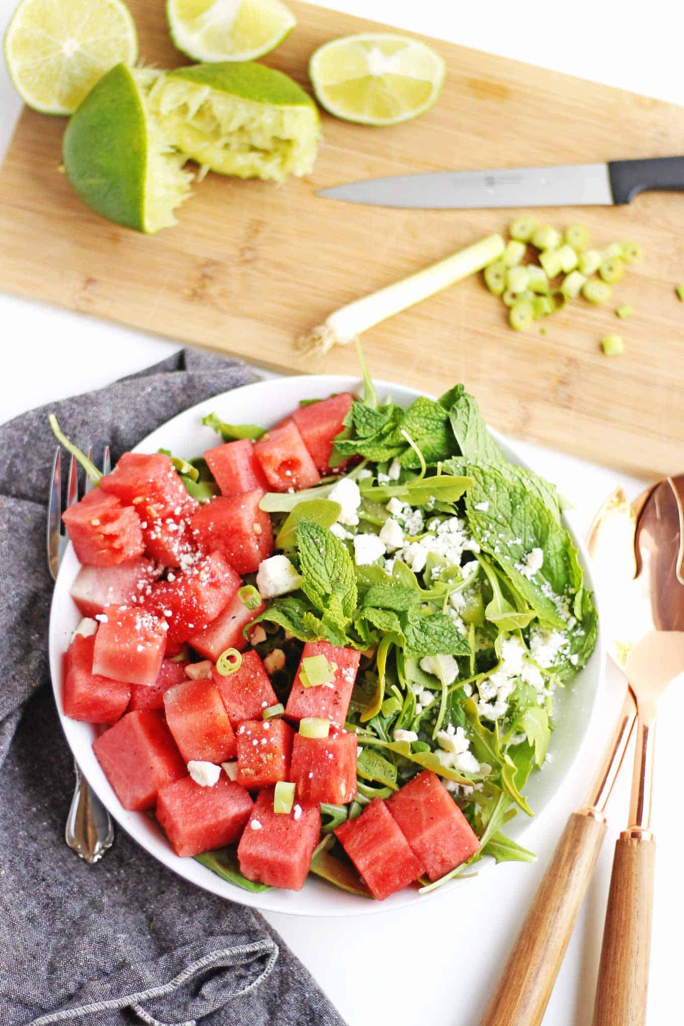 Super simple and refreshing spicy watermelon arugula salad. Perfect for hot summer days and barbecues, and ready in just 10 minutes! // Rhubarbarians