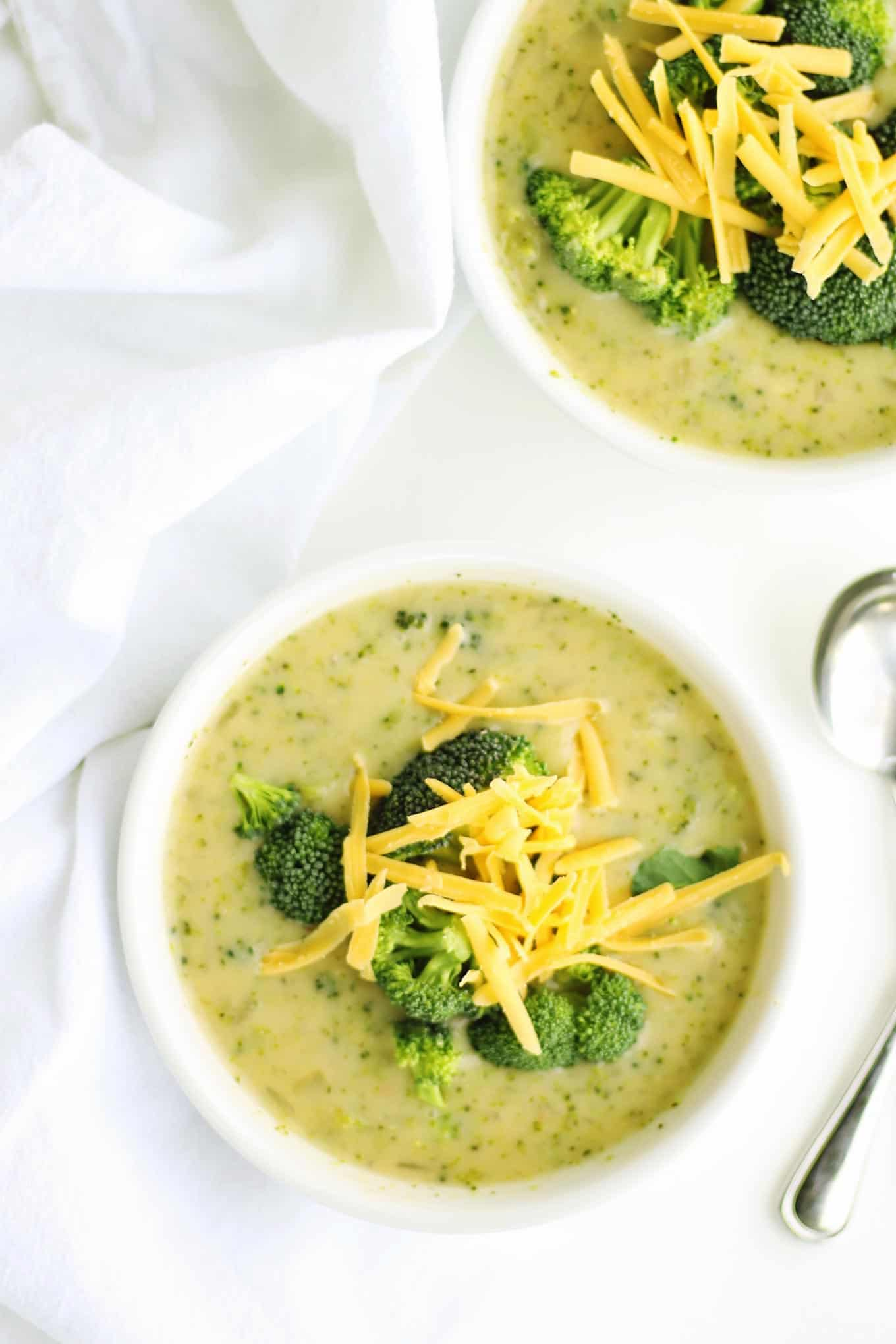 Healthy broccoli cheddar soup made with a secret ingredient! Just as delicious as the buttery, creamy version, but with so much more protein and fiber. YUM! // Rhubarbarians / #skinnyrecipes #healthyrecipes #vegetarian #recipe #broccoli #soup #comfortfood