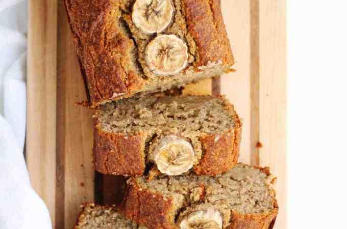 The best, healthy vegan banana bread recipe! Flourless, gluten-free, dairy free, and refined sugar free perfectly moist banana bread from the Nourish & Glow cookbook. // Rhubarbarians