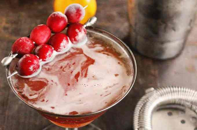 Cranberry orange autumn manhattan cocktail